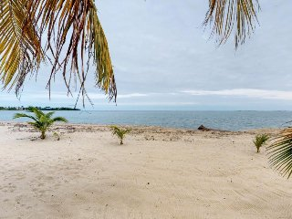 Upper-level beachside cabana with ocean views, moments from Placencia Sidewalk!