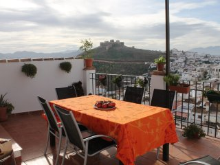 Beautiful restored home in the heart of Alora with spectacular views.