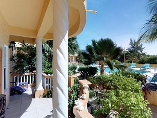 Oceanfront villa w/ a beach area, a fishing dock, and a covered balcony!