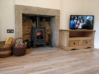 Light the real log fire for a welcoming glow in the living room.