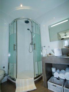 Masterbedrooms bathroom has separate walk in shower, vanity unity and toilet seat