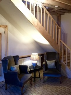 The welcoming main hall, cosy place to read and relax in front of the wood burning stove