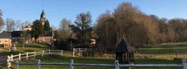 Winter time view of medieval church and well from the property