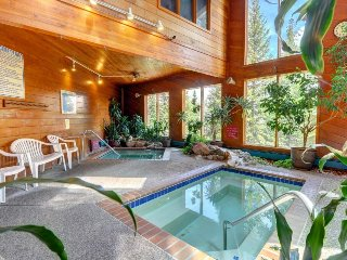 Modern mountain escape with shared pool, sauna, hot tub, and rec center access