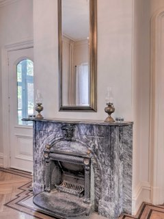 Warm up by multiple marble fireplaces throughout the house.