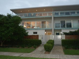 3 level townhouse with a private lift overlooking the Port Stephens waterway