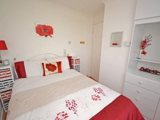 The main bedroom in Chalet 184 has a double bed and built in wardrobe and drawers