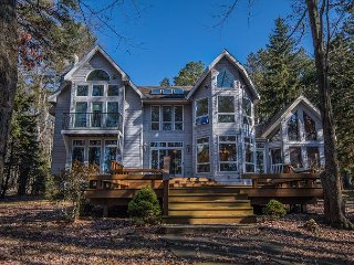 Amazing lake & sunset views, 2 master suites & private dock!