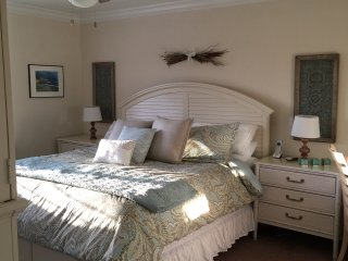 New King Bed, bedding,  and media chest in the Master Bedroom with walk in closet! Makeup area/desk.