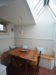 Dining room with vaulted ceiling
