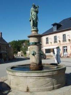 Fountain in village square.