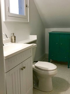 Bathroom, shower stall opposite the sink.