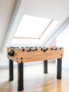 Attic bedroom, football table.