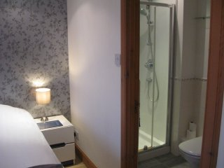 Master Bedroom, Super-king Bed, with En-suite Shower/Toilet and Cairngorm Mountain Views.
