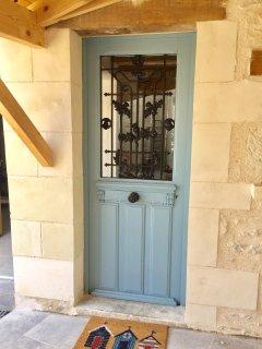 Blue door on courtyard veranda
