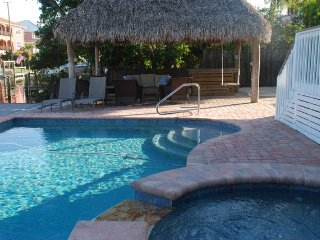 CANAL HOME W/HEATED POOL, HOT TUB, TIKI HUT, DOCK & OUTDOOR SHOWER.