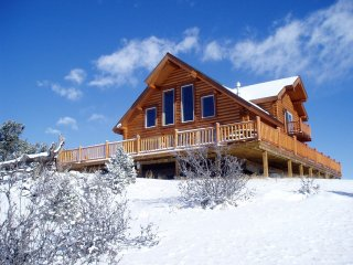 Secluded Log Chalet near to Ski Resorts & Adventures!! Priced Just Right!!