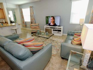 Comfortable Living Area w/ Flat Screen TV and Free Wi-Fi - View #2