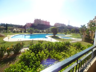 Stunning Coastal Apartment with Large Poolside Terrace. Wifi & Air Conditioning