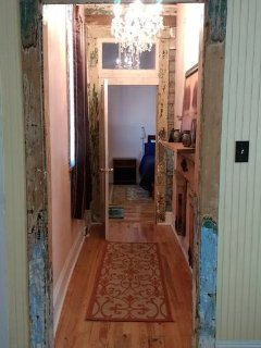 Hall to bedroom, walk in closet on other side with washer and dryer combo