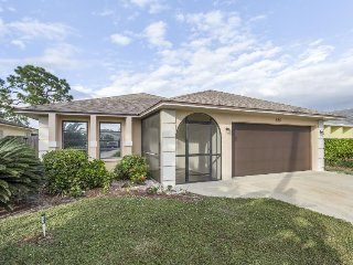 Home features peaceful enclosed porch, location near shops, dining & beach