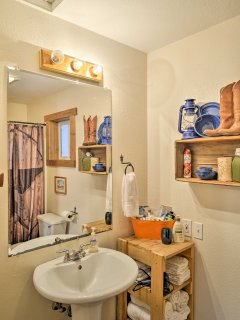 Get freshened up in the full bathroom after a long day spent hiking.