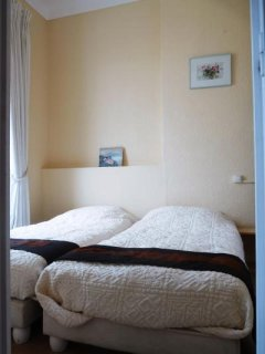 Twin beds in the first bedroom
