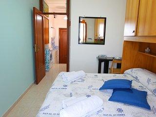 Stanza da letto con balcone vista mare e aria condizionata