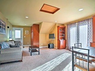 The clean, modern apartment features an open floor plan.