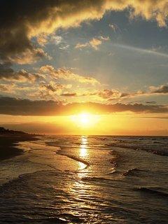 Beach Sunset in front of Ocean Dunes.