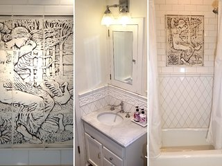 The bathroom with shower montage. Private but adjoining with Route 66 room when occupied.