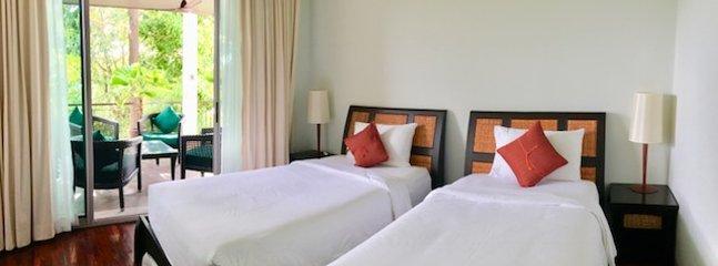 Guest Bedroom With Sliding Doors To Terrace.