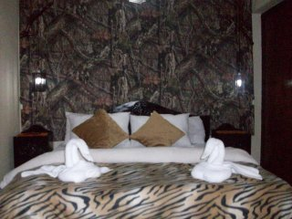 This room is the room with a queen size bed and a twin bed with attach bathroom with hot water