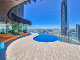 Brand New 2 Bdrs CITY apt with Infinity Pool