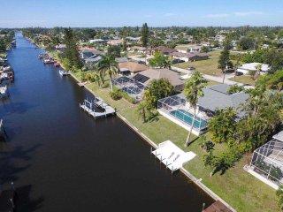 SWFL Rentals - Villa Amelia - Cozy Pool Home on Canal in SE Cape Coral Sleeps 6