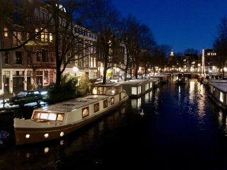 Luxury houseboat in historic, old city, Amsterdam.
