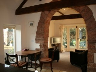 CRAWINLEY MILL HOUSE, all ground floor, private hot tub, romantic, near