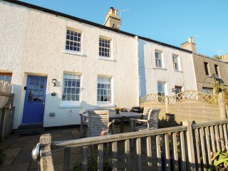 BAY COTTAGE, terraced cottage with sea views, woodburner, WiFi, terrace, close t