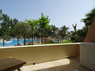 Apartment Oasis La Caleta with heated pool, only 200 m to the sea, balcony,wifi