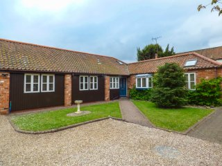 THE OLD WAGON SHED, super king-size, courtyard, hot tub, farmhouse, logburner, n