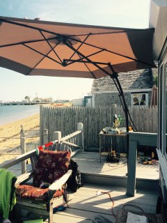 large umbrella...also 2 wooden adirondack chairs and a dining table for two on private deck.