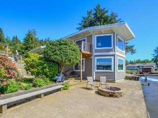 Dog-friendly home + guest cottage w/ private hot tub, deck, & lakefront views
