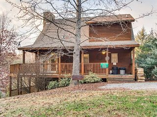 'Lucky Charm' is a cozy, 3 level log cabin situated on 3 acres.
