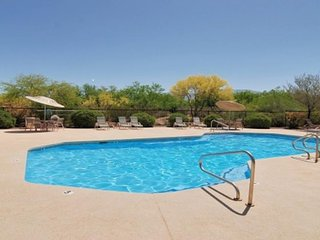 Dog-friendly condo offers a shared pool and hot tub, on-site golf course too!