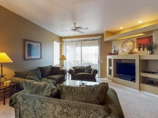 Lovely mountain view condo with balcony, shared pool/hot tub and golf onsite!