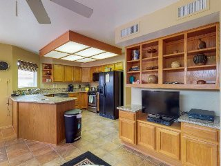 Vibrant, dog-friendly home with a furnished patio - close to shopping and dining