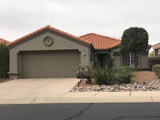 Bright and family-friendly home with a shared pool, hot tub, and onsite golf!