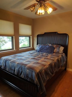 3rd Bedroom, with view of river and valley.  Flat screen TV, closet and drawer space.