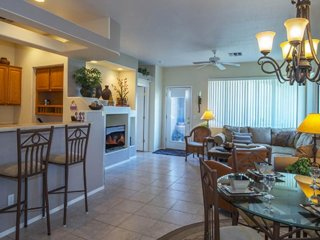 Mountain view condo with shared pool, hot tub, private balcony and golf onsite