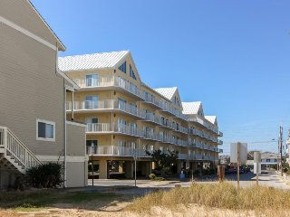 Partial oceanview escape w/ shared pool & prime location steps from the beach!